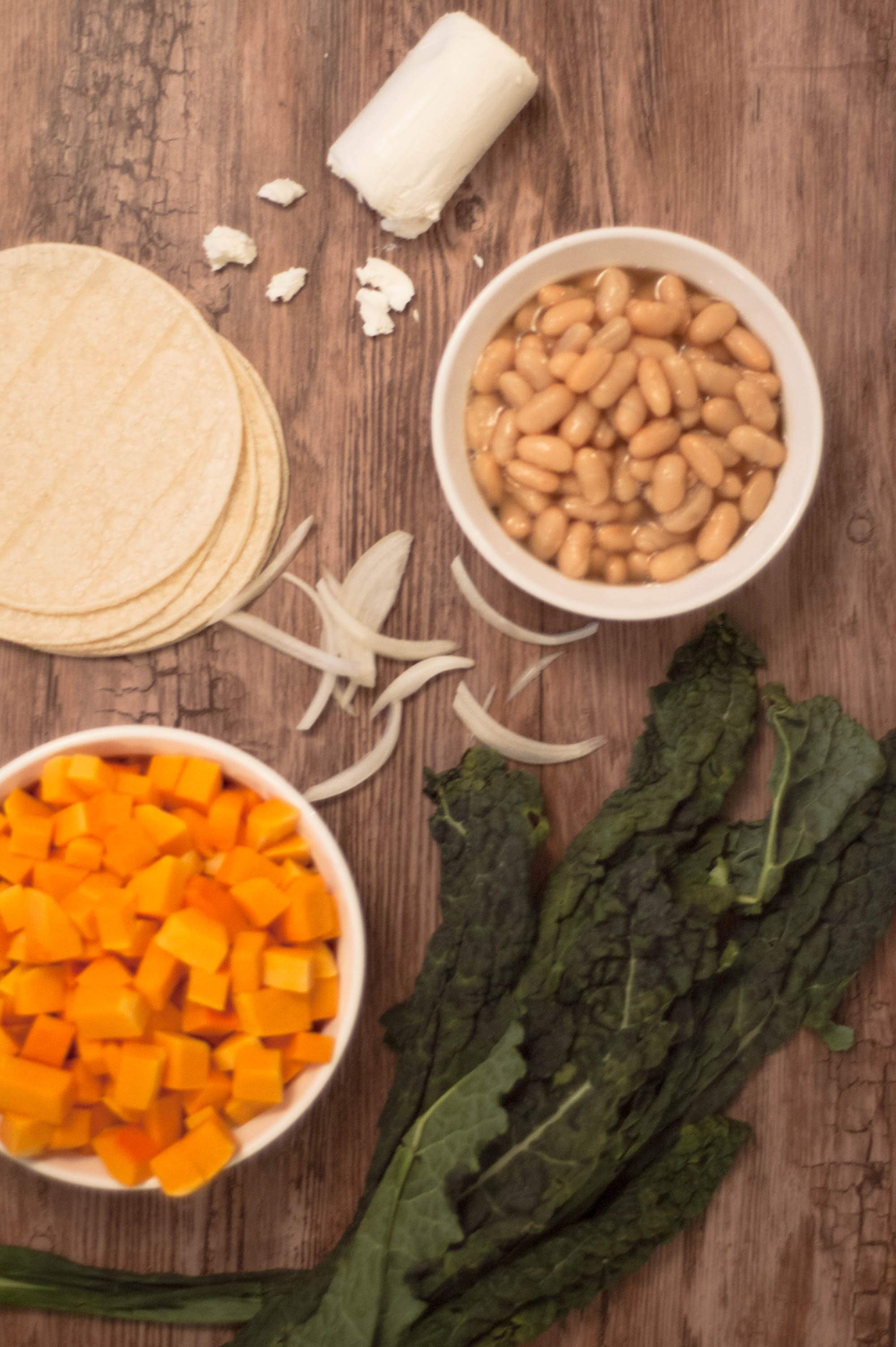 All of the ingredients to make pumpkin tacos in individual containers
