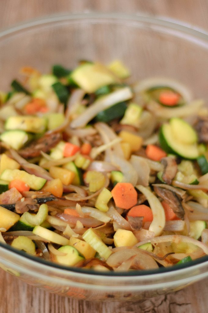 Autumn vegetable mixture of carrots, onions, zucchini, and turnips.