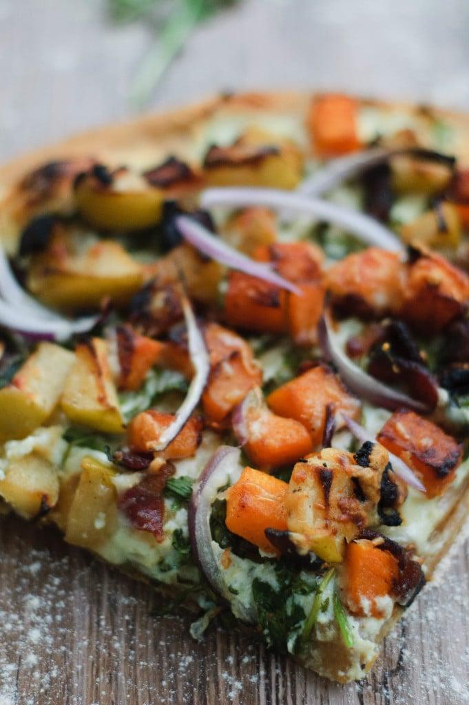 Close up of a slice of autumnal harvest pumpkin pizza.