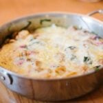 A pan with cheese covered pumpkin egg casserole