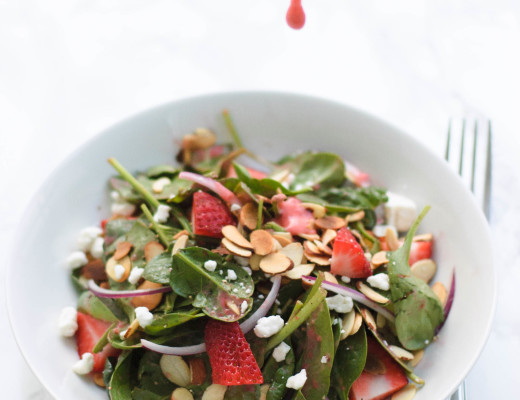 Enjoy this light and sweet strawberry, almond, and goat cheese salad that has a bright and zingy strawberry vinaigrette. The almonds give it a great crunch!