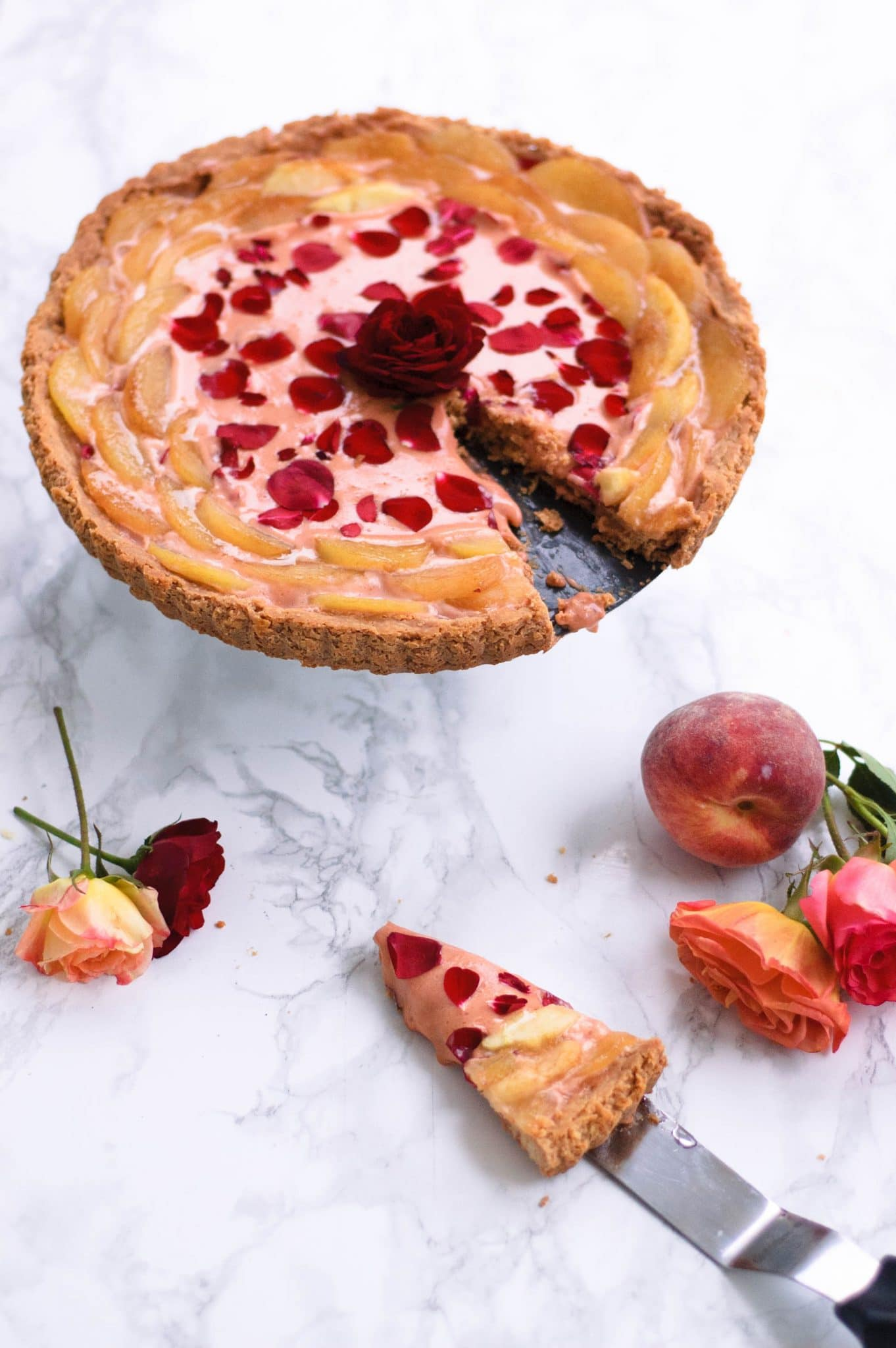 This Rose Curd and White Peach Tart is a beautiful way to enjoy the bounty of spring and summer edible flowers in a beautiful, light, and fresh dessert.