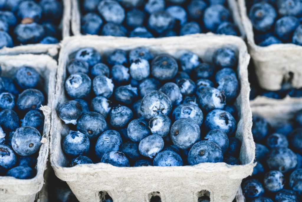 Five berry boxes of blueberries.