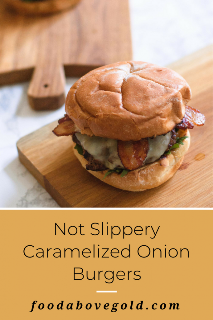 "Square image of cutting board with burger on top and text saying ""Not Slippery Caramelized Onion burger"""