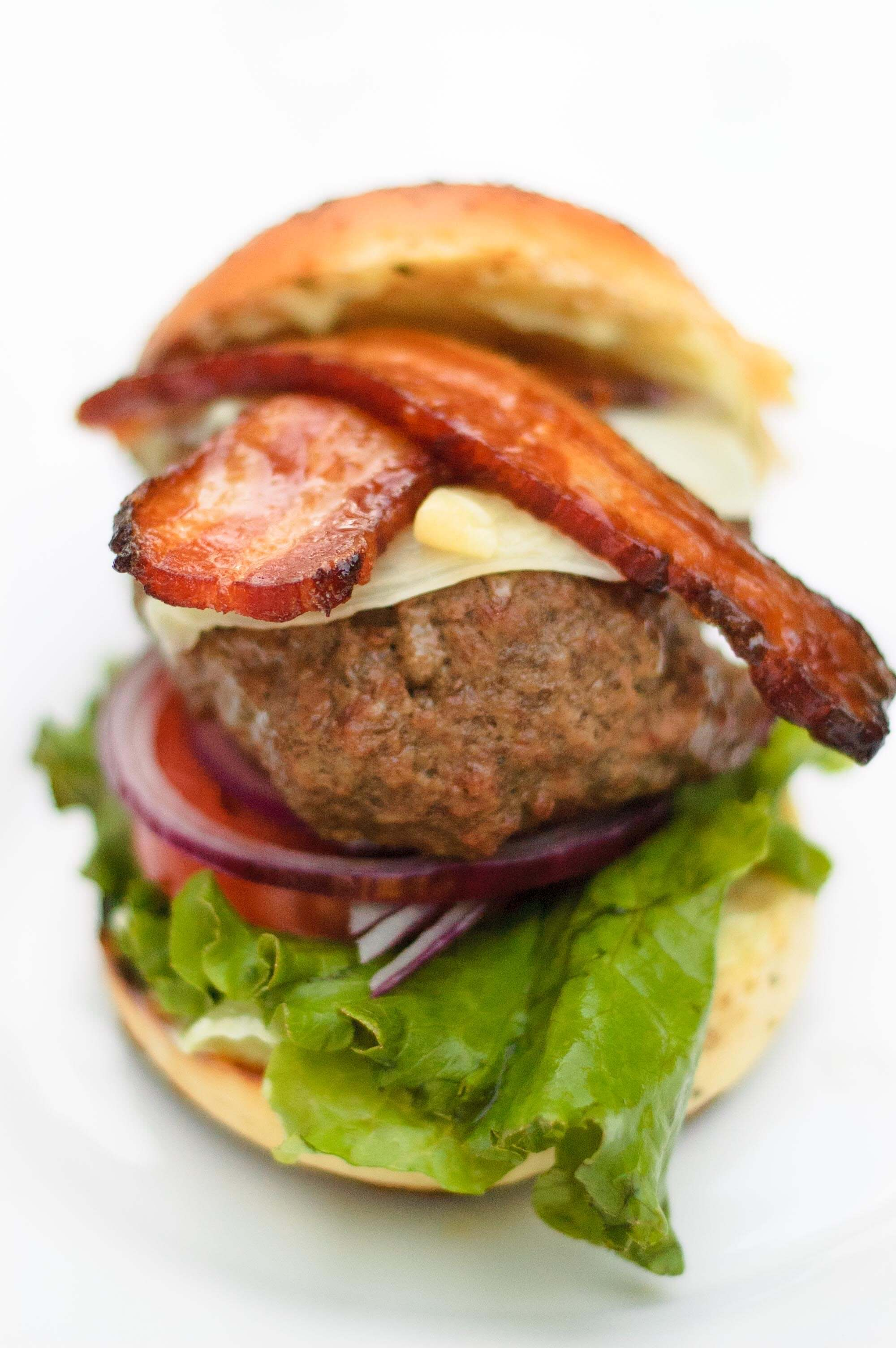 closeup of thick cut bacon on the wasabi burger