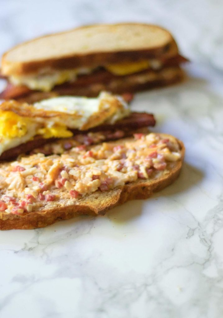 These Pimento Cheese, Bacon and Fried Egg Sandwiches are great for breakfast or dinner & finished in 30 minutes! Plus, a quick variation to make it spicy!