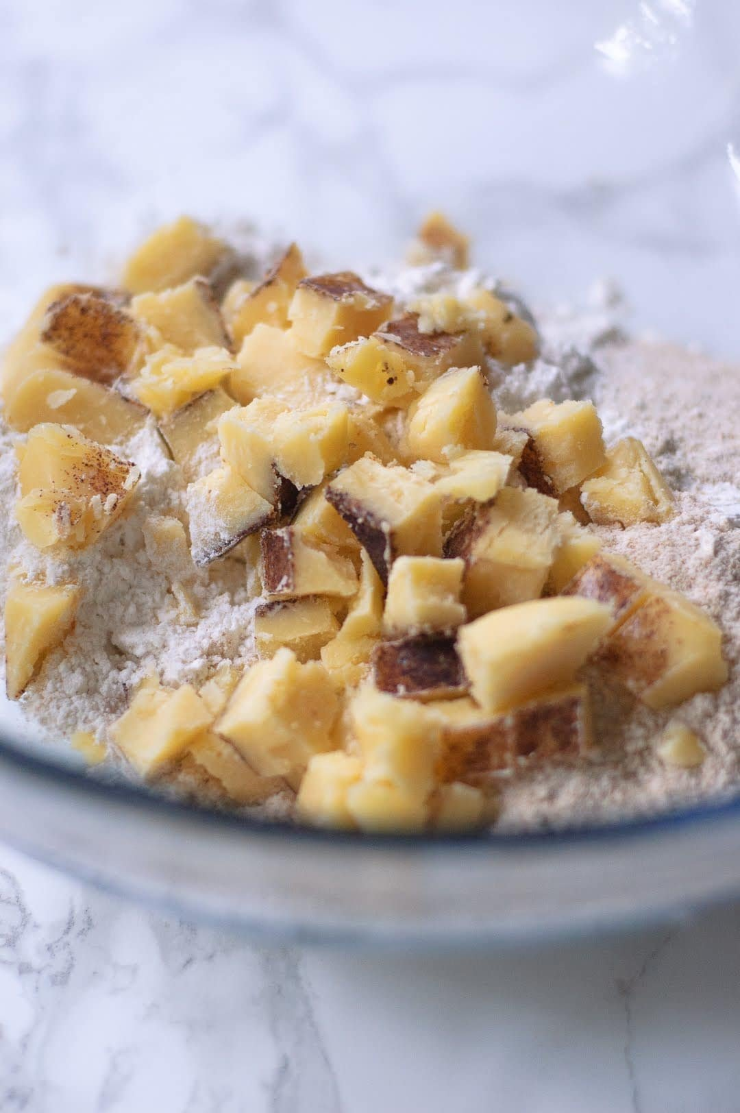 bowl of cut up brown butter in flour