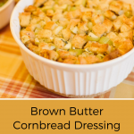 closeup of Brown Butter Dressing with Garlic and Herbs in white bowl on orange plaid tablecloth