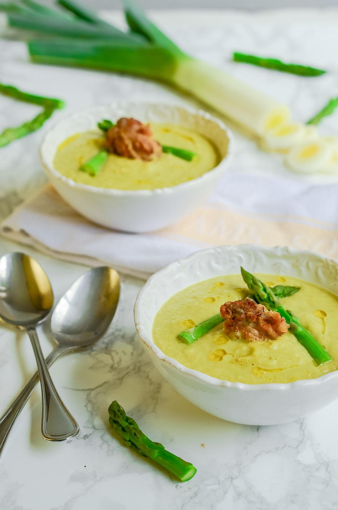 Whether you eat it as an appetizer or an entrée, get in the mood with the aphrodisiacs in this Caramelized Leek & Asparagus Bisque with Fried Oysters.
