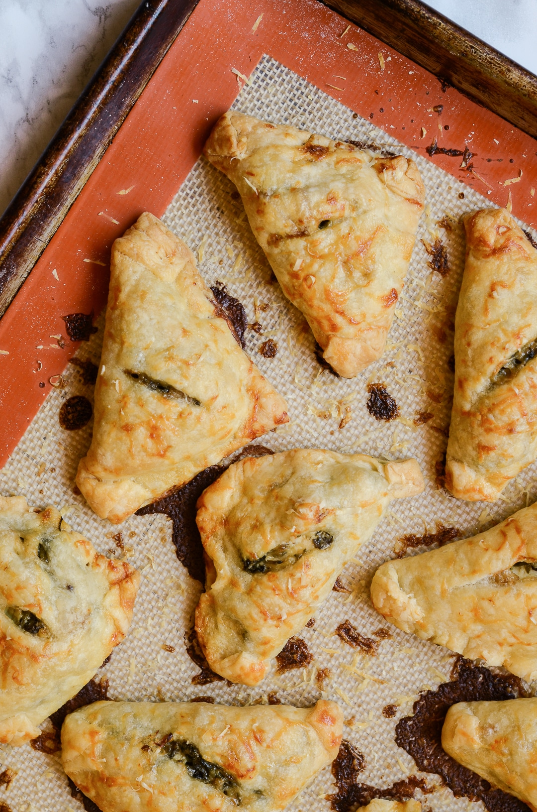 Be the hit of the party (or cookout) with these deliciously fluffy Mini Chicken Bacon Spinach Artichoke Hand Pies. They're the perfect finger food appetizer for any occasion!