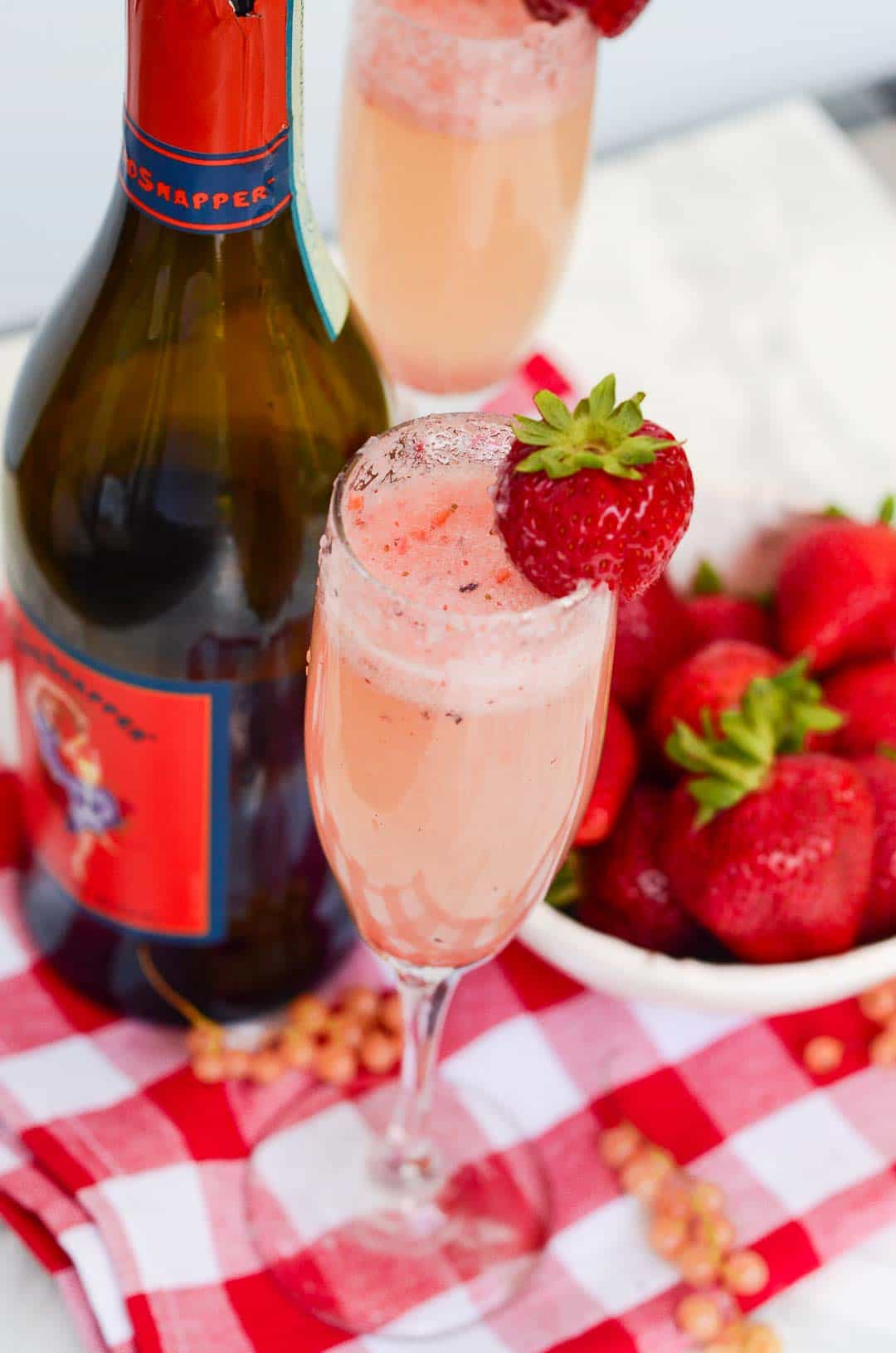 Toast your day and use fresh summer produce with this semi-sweet Strawberry and White Currant Bellini Cocktail. Day drinking never tasted so good!