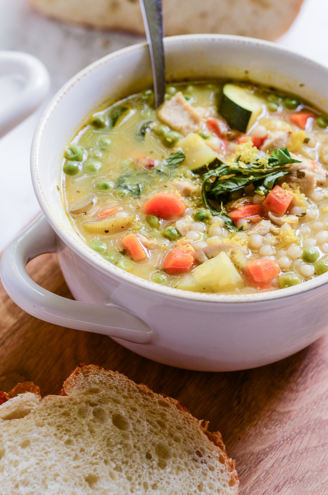 "This Lemony Couscous Soup with Chicken and Spring Vegetables is great during every season and is a perfect ""get well soon"" pick-me-up."