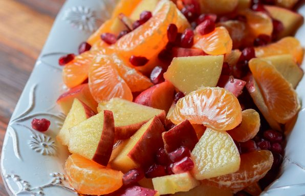 A bowl of winter fruit salad with cinnamon vanilla dressing