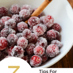 """Close up image of sugared cranberries with """"3 tips for making stunning sugared cranberries"""" text"""