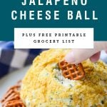 "A hand dipping a pretzel into a jalapeno cheese ball with title text ""Fire Roasted Jalapeno Cheese Ball"""