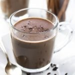 hot chocolate in a glass mug with spoon
