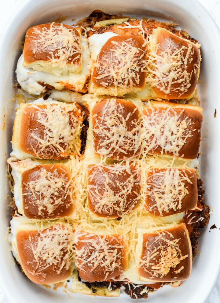 pan of cooked pesto chicken parmesan sliders