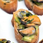 Close up of Crostini on a white tray
