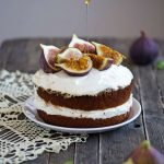 Cake toped with fresh figs on a doily