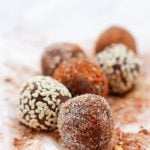 closeup of eight truffles on chile powder
