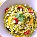 White bowl of cilantro pesto pasta