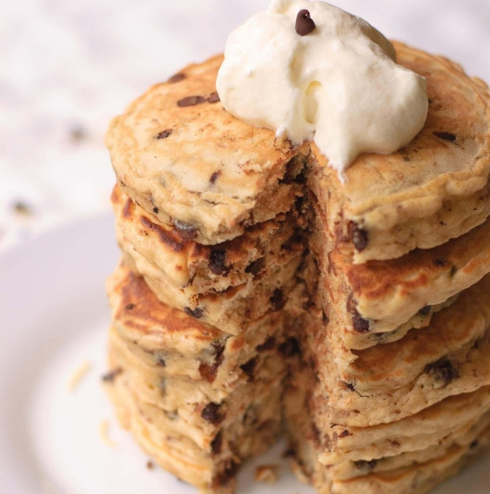 plate of Chocolate Chip Pancakes with Toasted Coconut topped with whipped cream