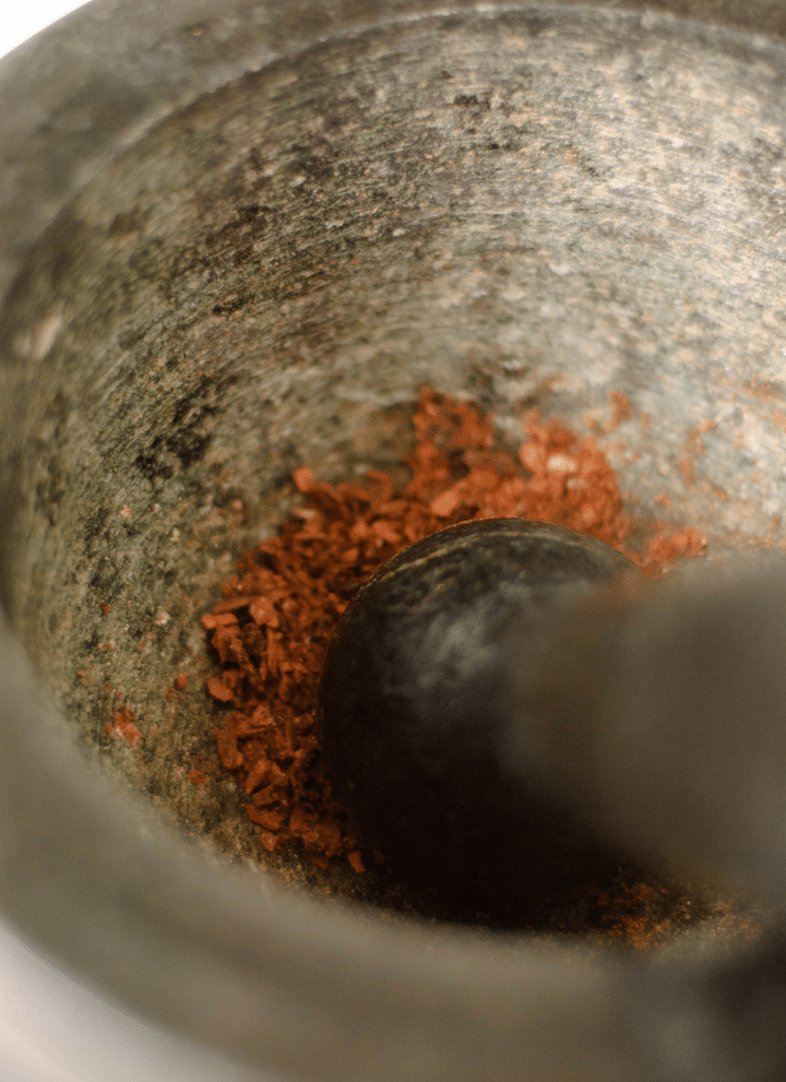 Spices ground in a mortar and pestle