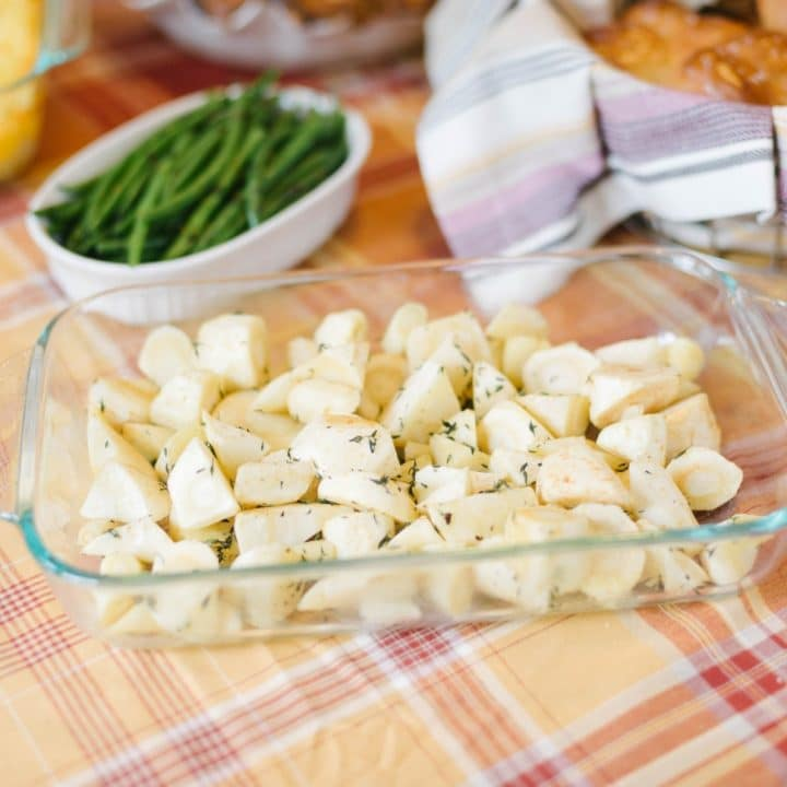 A clean dish of easy roasted parsnips on an autumnal colored tablecloth
