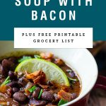 "Title Text ""Black Bean Soup With Bacon"" over an image of soup in a red mug"