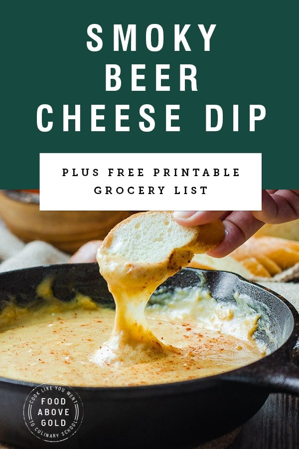 """Title text """"smoky beer cheese dip"""" over a picture of bread being dipped into dip"""