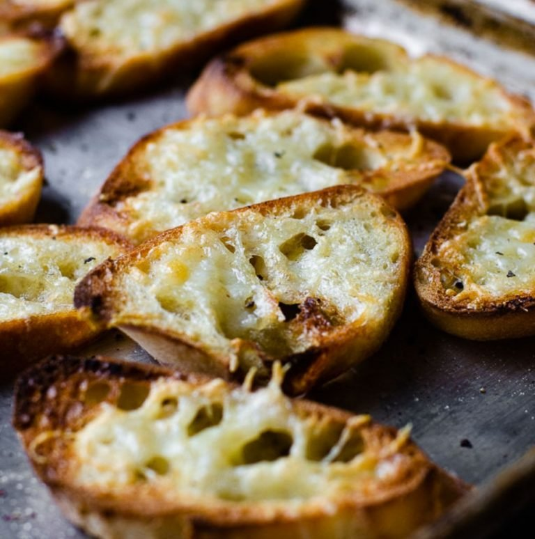 slices of homemade garlic toast on a sheet pan