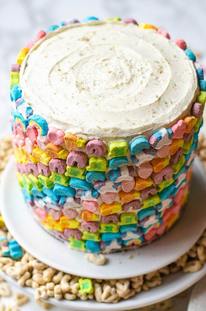 swirled frosting on top of a lucky charms cake