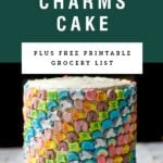 A tall decorated lucky charms cake. Recipe title above it is on a green background.