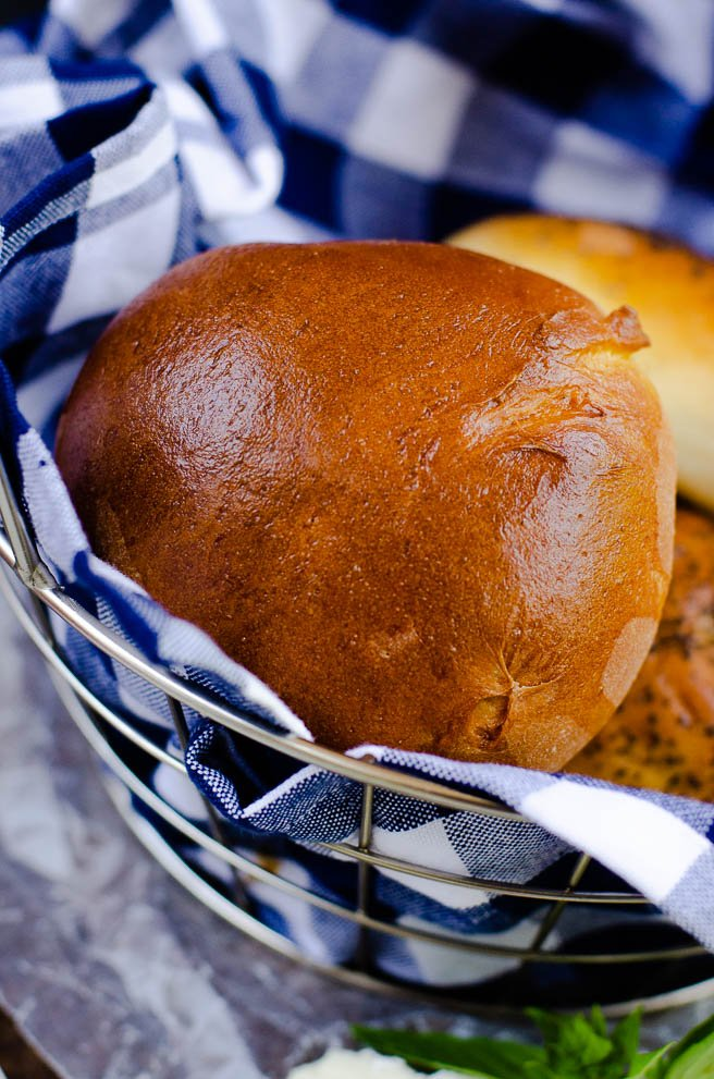 Basket of golden brown brioche hamburger buns