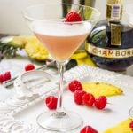 a tray of fruit with a french martini