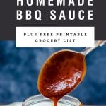 A spoon lifting homemade bbq sauce out of a mason jar. Recipe title above it is on a black background.