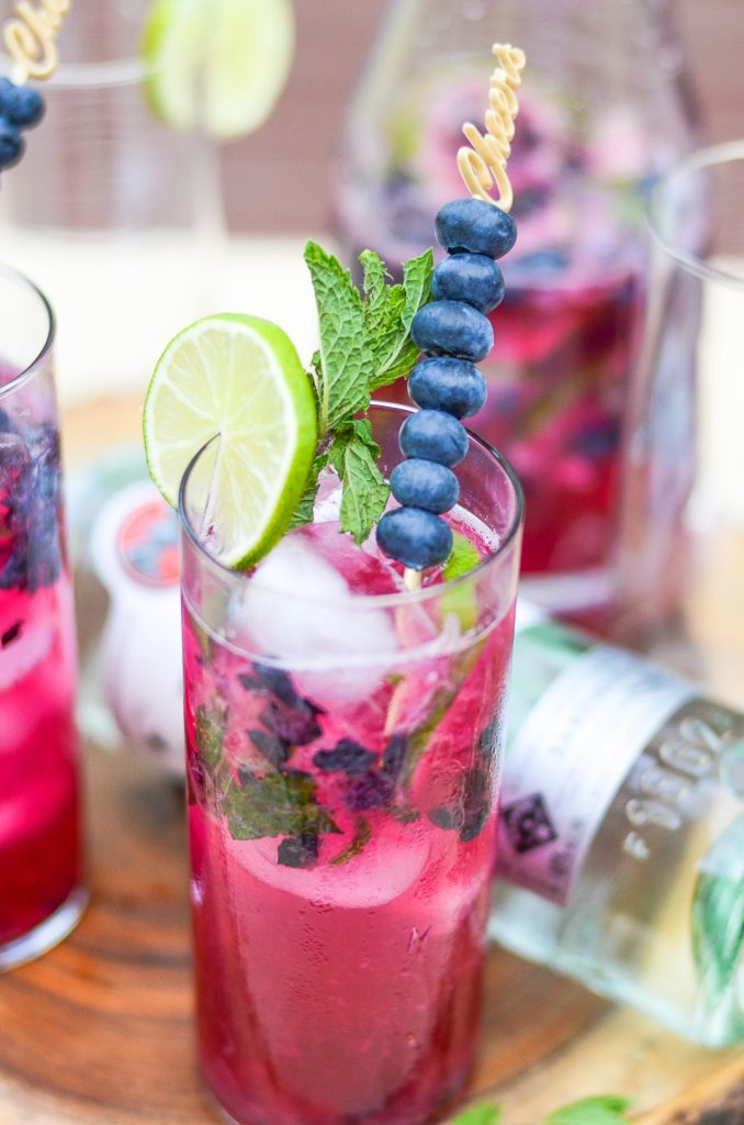 Close up of a glass of blueberry mojito