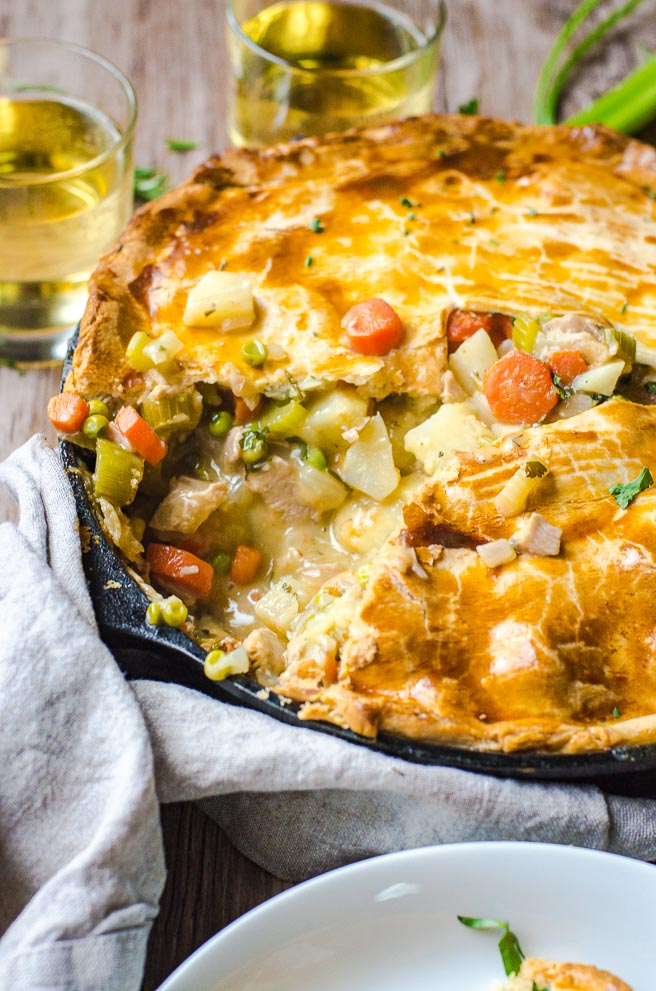 A view of the inside of a cooked turkey pot pie showcasing the gravy.