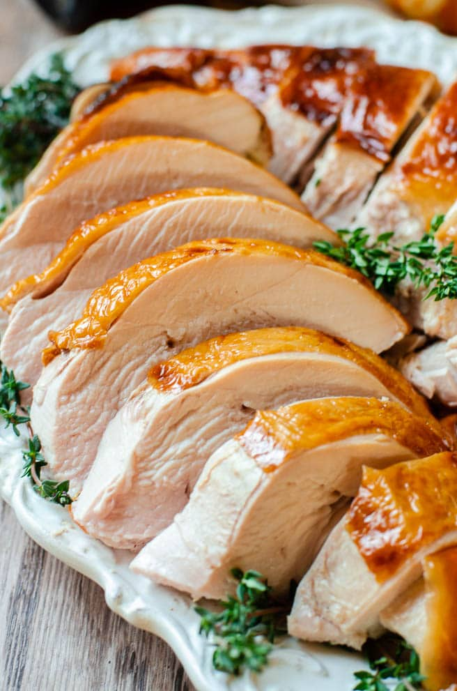 The moist and juicy inside of a roasted turkey breast arranged on a platter.