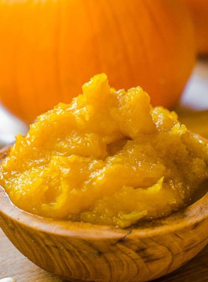 Close up of an overflowing bowl of homemade pumpkin puree.