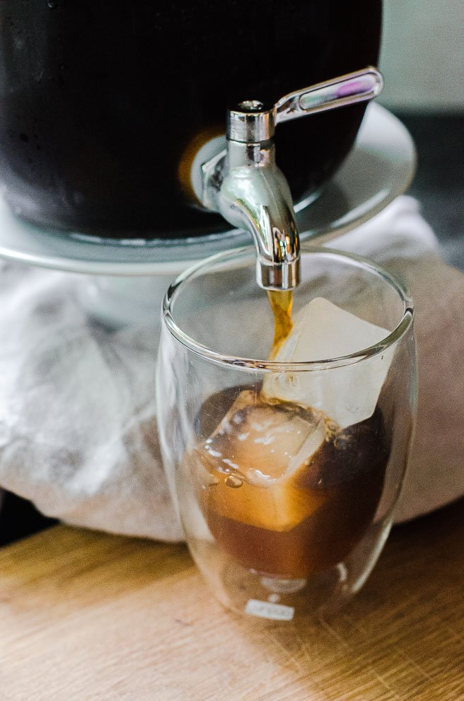 Coffee pouring onto square ice cubes.