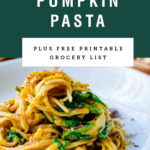 A tall serving of pumpkin pasta on a plate. Recipe title above it is on a green background.