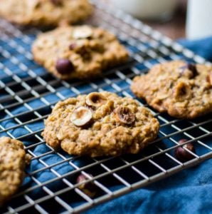 Chewy hazelnut oatmeal cookies on a cooling rack.