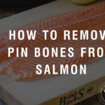 "A salmon fillet on a cutting board with a black overlay and text saying ""how to remove pin bones from salmon""."