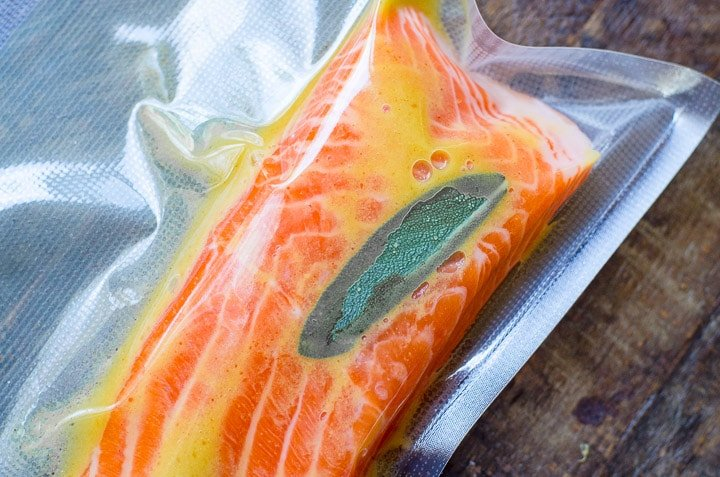 A vacuum sealed bag of maple dijon salmon ready to go into the sous vide.