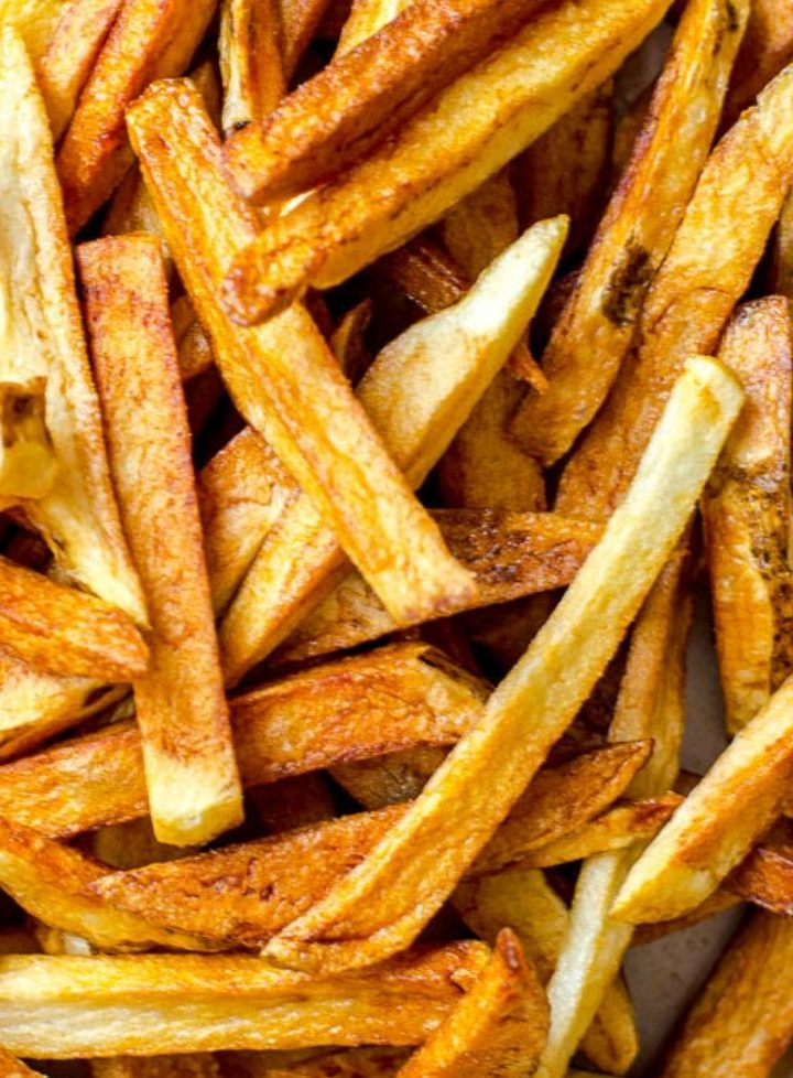 A large pile of golden brown homemade french fries.