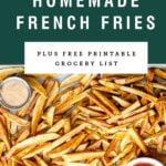 Overhead view of homemade french fries on a sheet pan with dipping sauces. Recipe title above it is on a green background.
