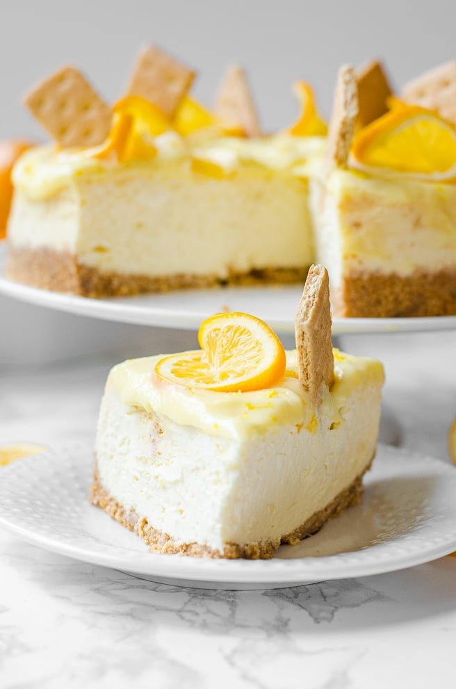 Straight on view of the point of a slice of meyer lemon cheesecake.