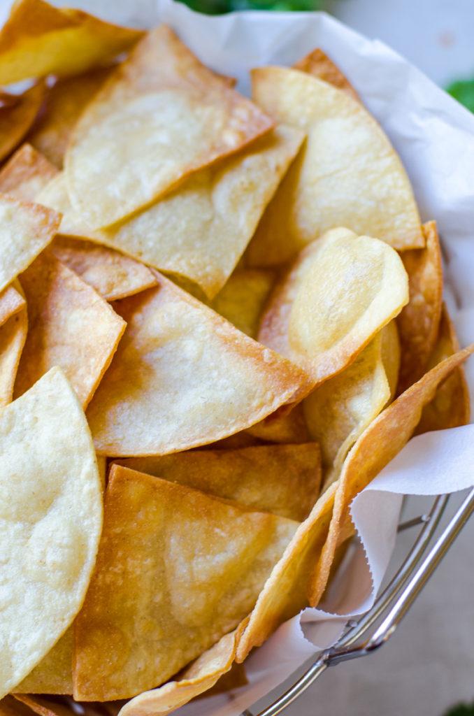 Close up of a basket of crispy chips.