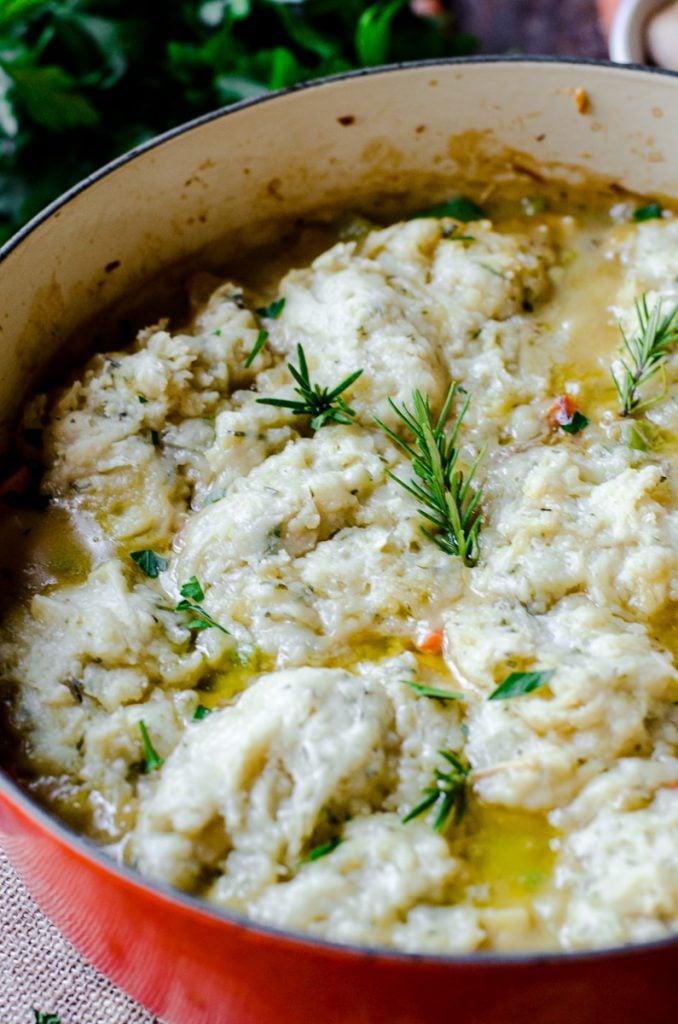 Cooked dumplings on top of soup.
